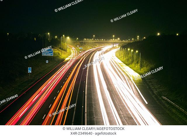 Traffic trails on the M6 Dublin to Galway motorway at the Tyrellspass Junction, County Westmeath, Ireland