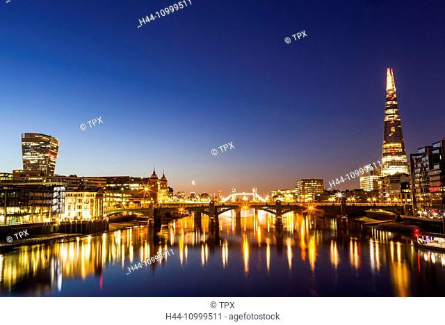 England, London, Thames River and London Skyline at Dawn