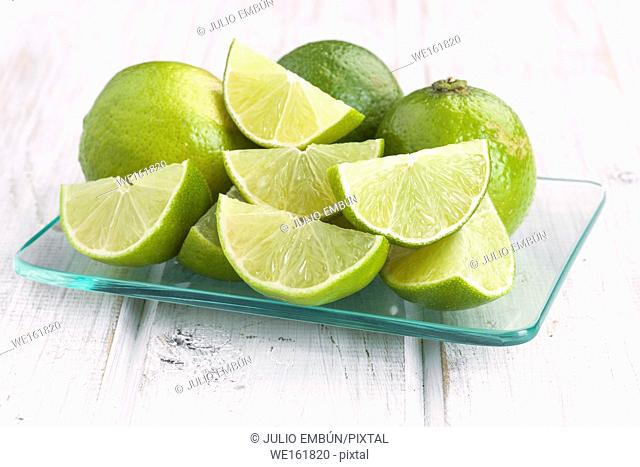 cut limes in glass tray