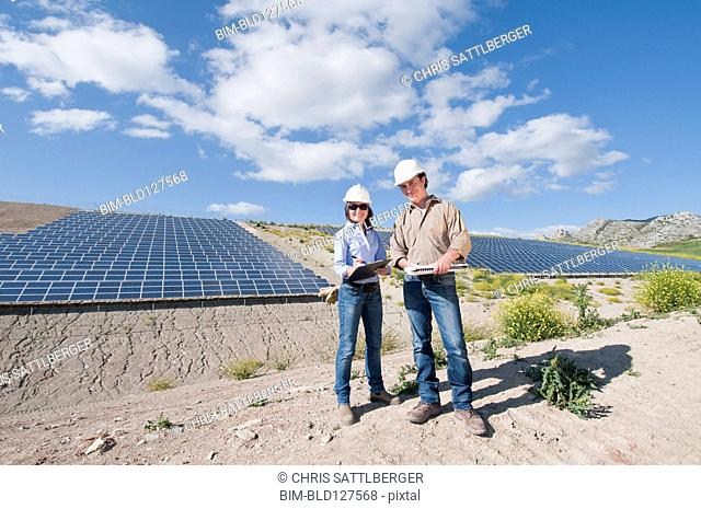 male and female engineer in solar plant