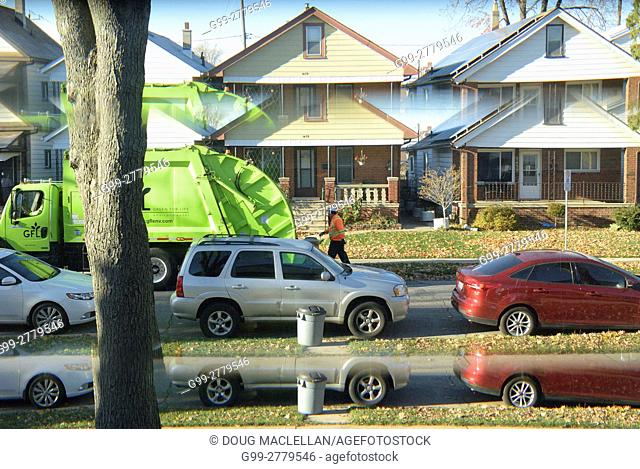 Garbage pick up day as seen through a front door window giving a split image, Windsor, Ontario