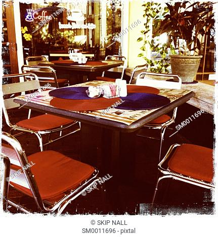 A table and chairs at an outdoor cafe in Florida