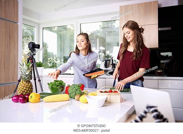 Bloggers cooking in modern kitchen