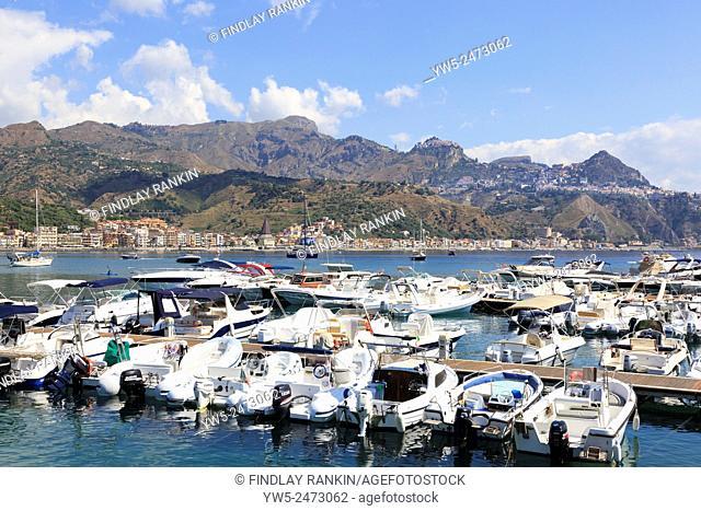 Giardini Naxos bay with a view to Cape Taormina mountains, Sicily, Italy