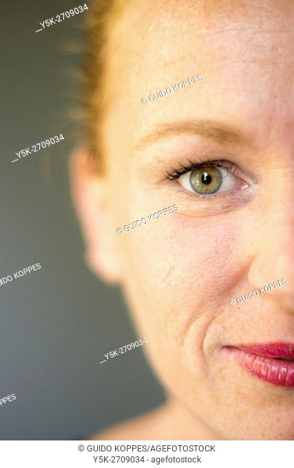 Tilburg, Netherlands. Close up studio-portrait of a red-haired woman