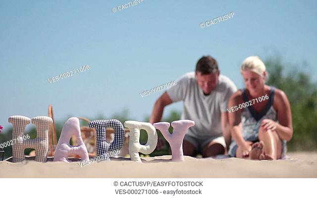 Blurred background of family having rest on beach
