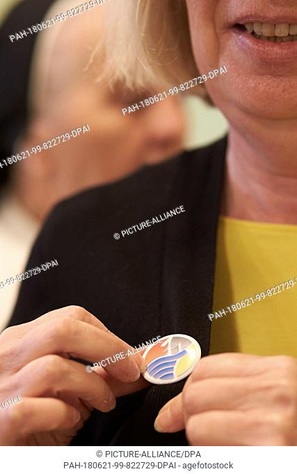 21 June 2018, Germany, Koblenz: Guests, who do not want to be addressed, wear a silence button at the Arenberg monastery