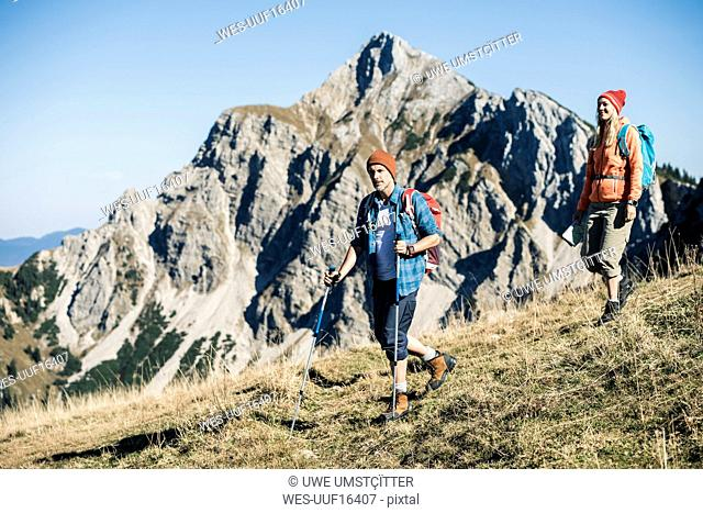 Austria, Tyrol, couple hiking in the mountains