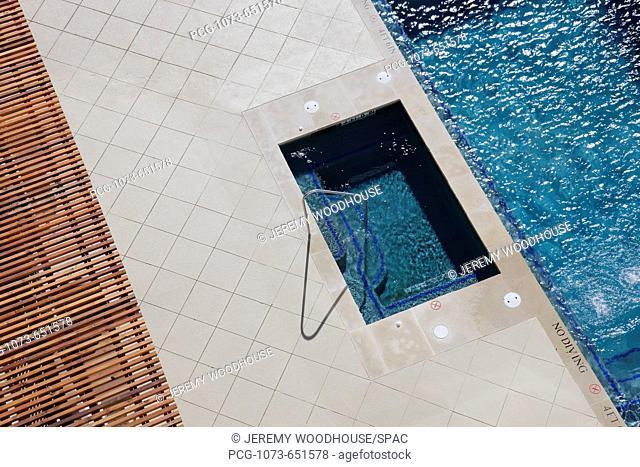 Hot Tub Next to Swimming Pool