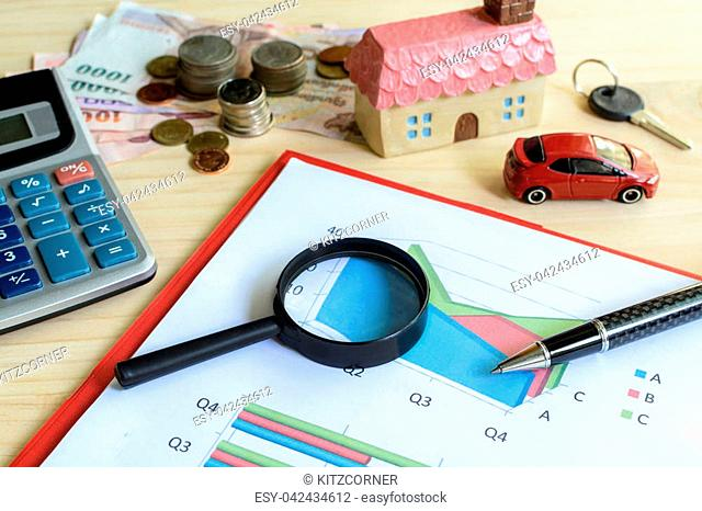 Home and car finance concept, residential house, expenses calculated