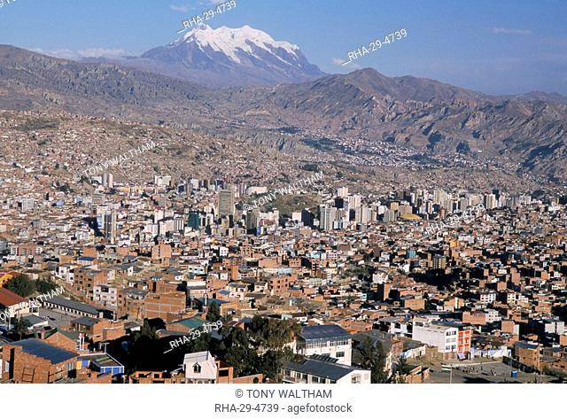 View across city from El Alto, with Illimani volcano in distance, La Paz, Bolivia, South America