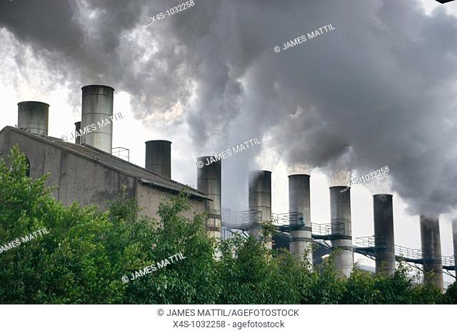 Smoke bellows from somestacks at a Mexican sugar refinery