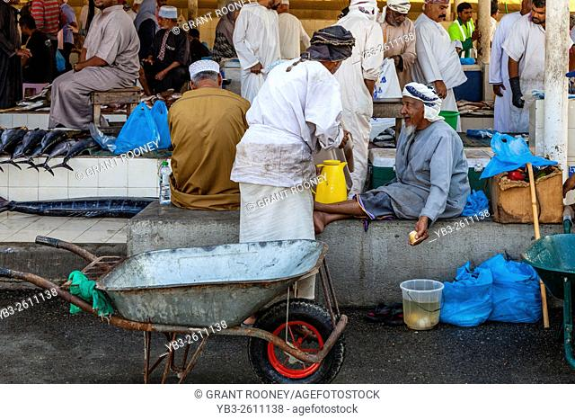 Omani Men At The Fish Market, Muttrah, Muscat, Sultanate Of Oman