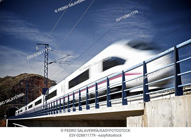 view of a high-speed train crossing a viaduct in Purroy, Zaragoza, Aragon, Spain. AVE Madrid Barcelona