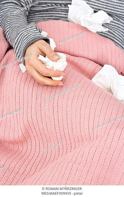 Close-up of sick woman with tissues