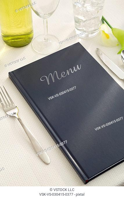 Place setting with cutlery and menu