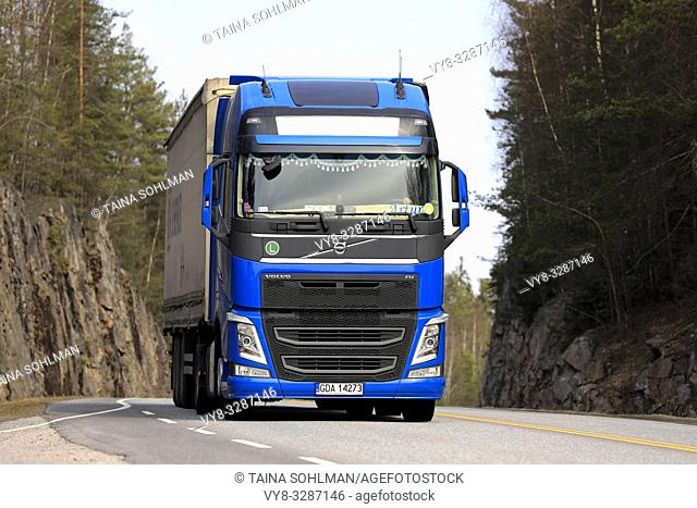 Salo, Finland - April 5, 2019: Blue Volvo FH semi trailer up front, transporting goods along highway on a day of spring