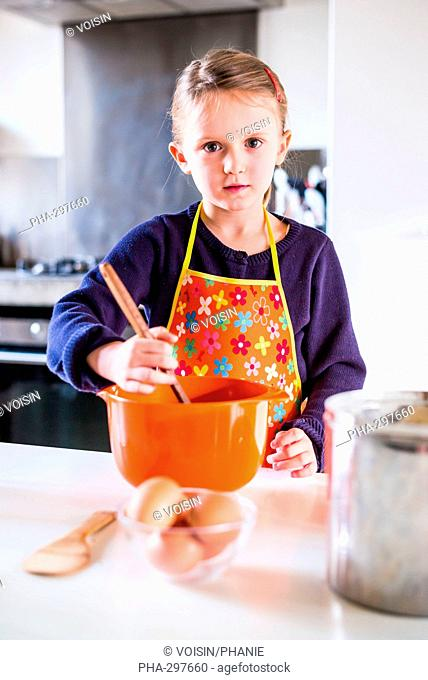 5 year-old girl learning cooking