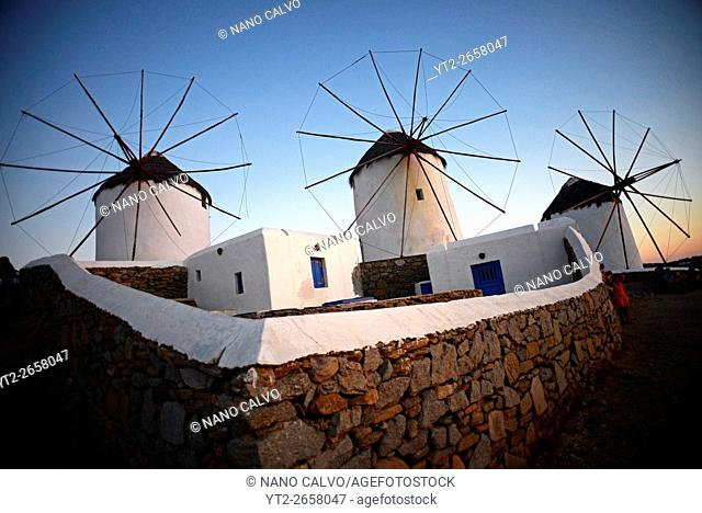 Traditional windmills (Kato Milli) at sunset in Mykonos town, Greece