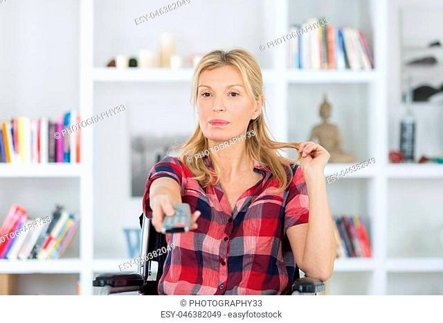 disabled woman in wheelchair watching movies at home