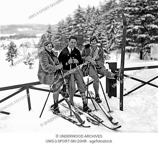 New York: c. 1925.Three fashionable skiers take a break from skiing