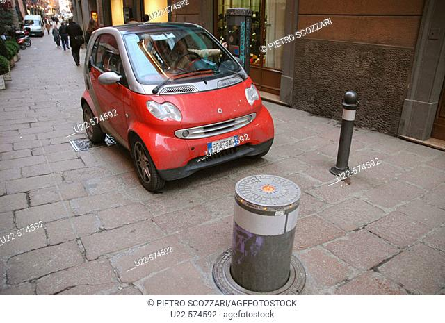 Smart-car, leaving the historical centre of Bologna. Emilia-Romagna, Italy