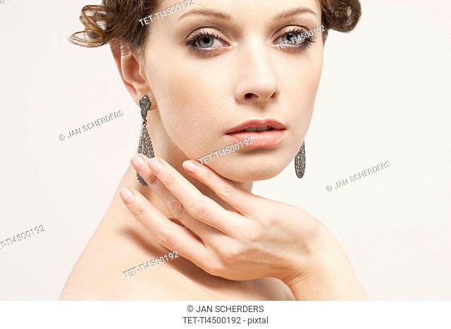 Portrait of beautiful young woman, studio shot