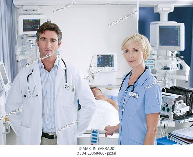Doctor and nurse standing in intensive care