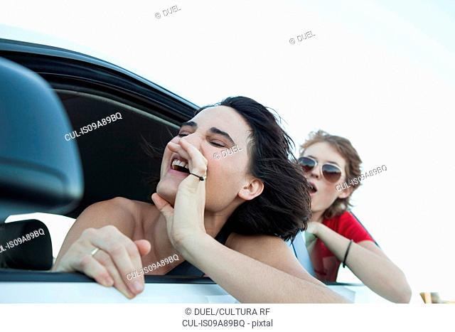 Woman shouting through car window
