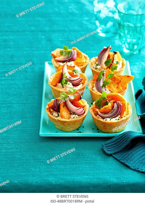 Plate of baked vegetable tarts