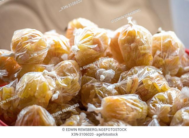 Sugary sweets sit in bags in Ganta, Liberia