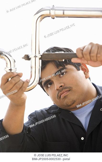 Plumber working on U bend