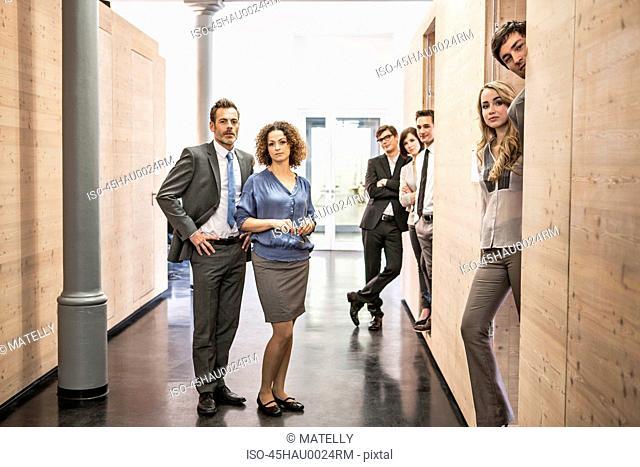 Business people standing in hallway