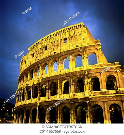 sgm70031 Colosseo, Colosseum at dusk with stormy sky, Rome, Italy