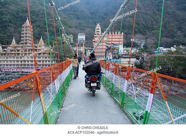Lakshman Jhula, a bridge crossing the Ganges at Muni Ki Reti, near Rishikesh, Tehri Garhwal district, Uttarakhand, India