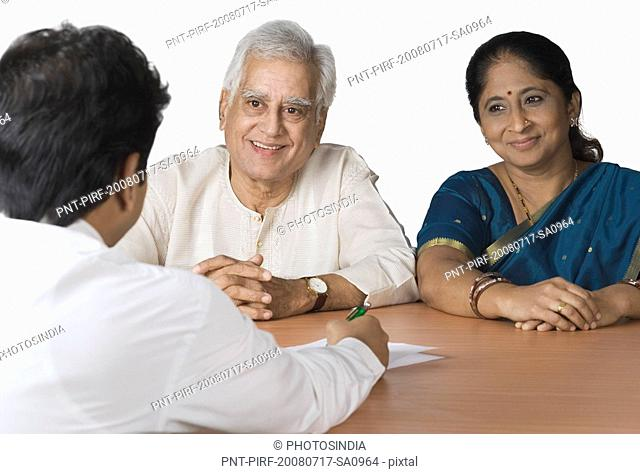Couple discussing with a financial advisor