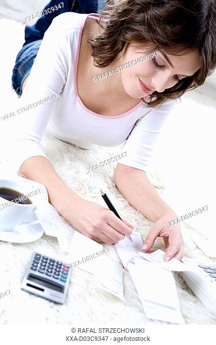 woman counting her bills at home