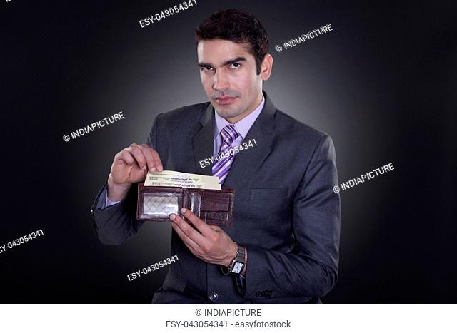Portrait of businessman with currency in wallet