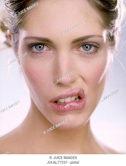Close up of woman biting her lip