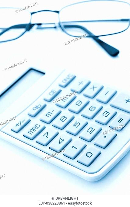 Simple yellow calculator with reading glasses on a white background