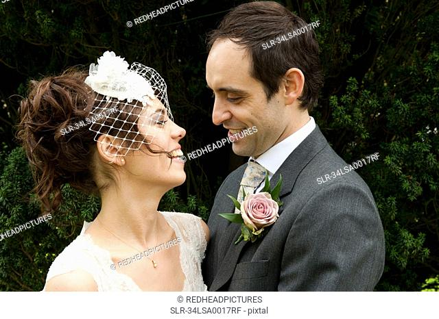 Newlywed couple smiling together