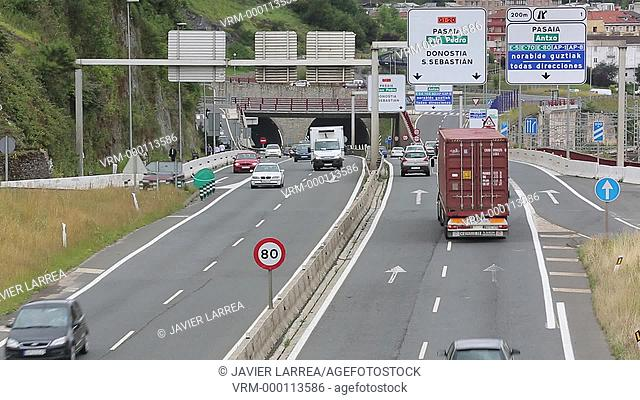 Car and truck traffic on the motorway, Gipuzkoa, Basque Country, Spain