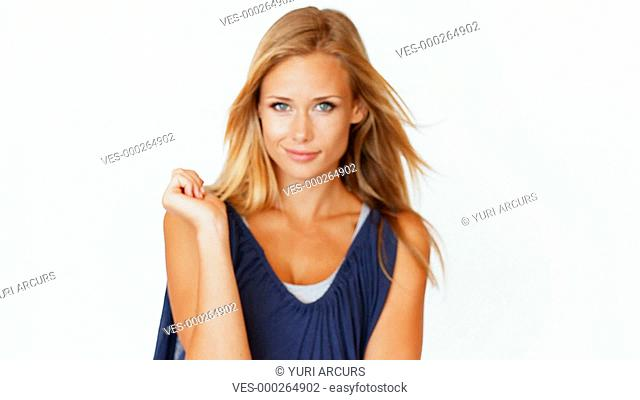 A stunning woman smiling at you as she flirts with the camera isolated on white