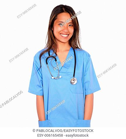 Portrait of a smiling asiatic nurse woman with stethoscope looking at you on blue uniform against white background