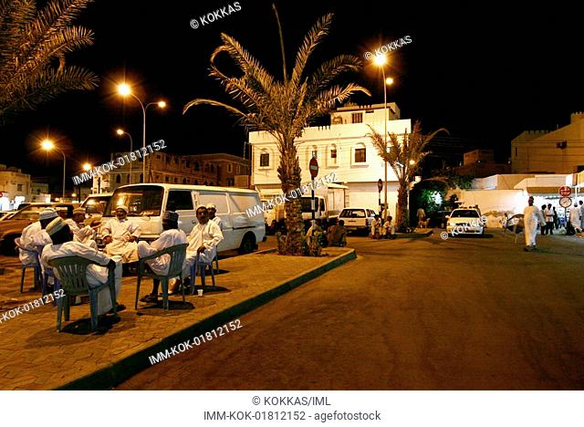 Mutrah District, men sitting outside, night , Muscat, Oman, Middle East