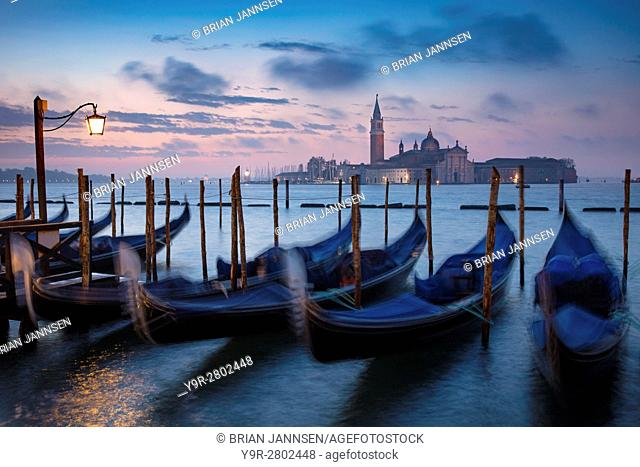 Pre-dawn light over gondolas and San Giorgio Maggiore, Venice, Veneto, Italy
