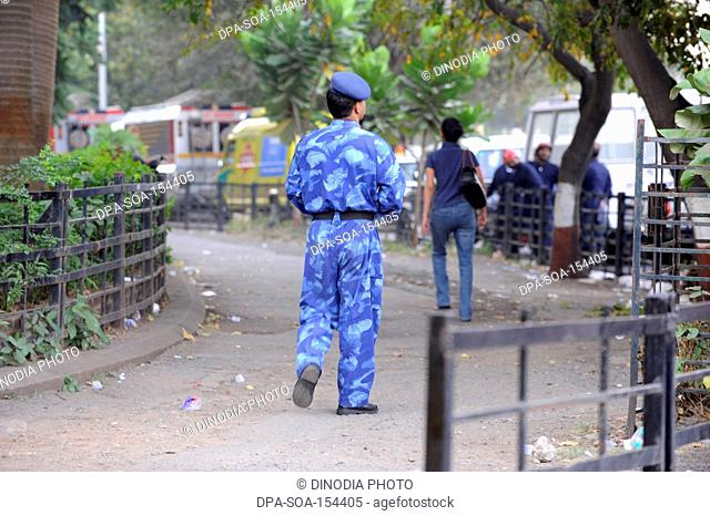 Rapid Action Force RAF Commando opposite Oberoi Trident hotel after terrorist attack by Deccan Mujahideen on 26th November 2008 in Bombay Mumbai ; Maharashtra ;...