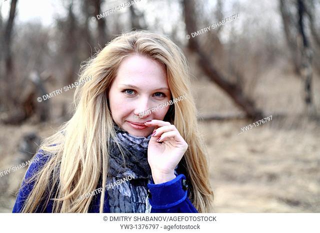 Portrait of beautiful woman in autumn