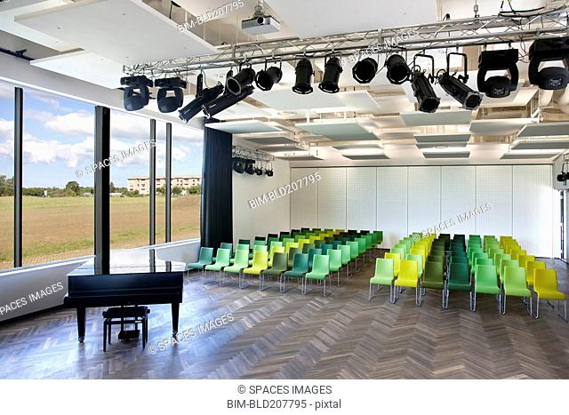 Chairs and grand piano in empty room