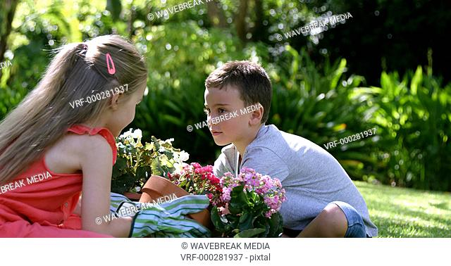 Cute brother and sister gardening